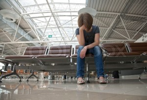 Sitting-young-girl-sitting-in-the-airport-waiting-room_colourbox.com_image